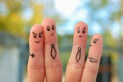 Fingers art of happy couple. Concept of office romance. People laugh at them royalty free stock images