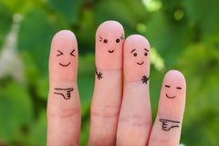 Fingers art of people. Concept woman taller than man, around laugh at them stock photo