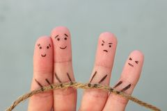 Fingers art of people. They playing tug of war stock images