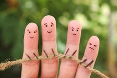 Fingers art of people playing tug of war with rope stock images