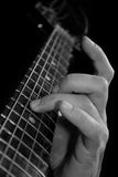 Fingers on bass fingerboard Stock Images