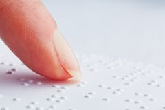 Fingers and Braille. Blind read. Stock Images