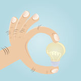 Fingers with bulb retro comic. Clipart of fingers with bulb Stock Photo