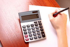 Fingers and calculator Royalty Free Stock Image