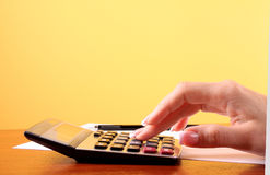 Fingers and calculator Stock Photography