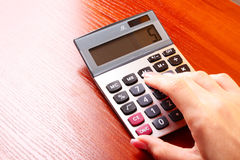 Fingers and calculator Royalty Free Stock Photography