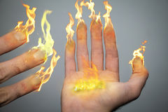 Fingers of candles. A right hand and fingers are on fire like candles or torches. Being an inspiration of the Hanukiah (menorah). 8 fingers symbolizing the Stock Photo