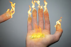 Fingers of candles. A right hand and fingers are on fire like candles or torches. Being an inspiration of the Hanukiah (menorah). 8 fingers symbolizing the Stock Photography