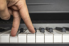 Fingers click on the piano keys. As if the legs are walking Royalty Free Stock Image
