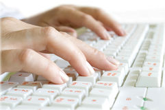 Fingers on the computer keyboard Stock Images