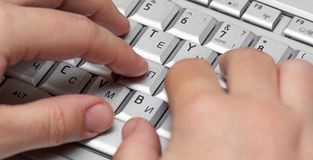 Fingers on computer keyboard Royalty Free Stock Photos