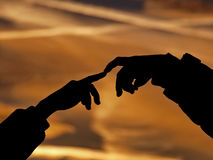 Fingers connection at sunset Stock Photo