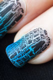 Fingers with craquelure nail polish manicure Stock Photos