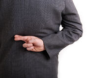 Fingers crossed. A conceptial image of a business man with his fingers crossed behind his back Royalty Free Stock Photo