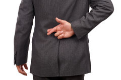Fingers crossed behind businessmans back Stock Image
