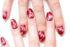 Fingers with decorated nails royalty free stock photography
