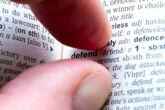 Fingers with defend text Stock Images