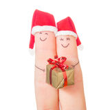 Fingers faces in Santa hats with gift box. Stock Image