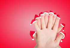 Fingers faces in Santa hats. Happy family celebrating Royalty Free Stock Photos
