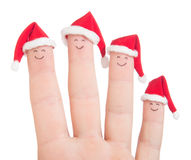 Fingers faces in Santa hats. Happy family celebrating concept. Fingers faces in Santa hats isolated on white background. Happy family celebrating concept for royalty free stock images