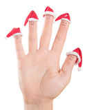 Fingers faces in Santa hats. Happy family celebrating concept. Fingers faces in Santa hats isolated on white background. Happy family celebrating concept for royalty free stock photography