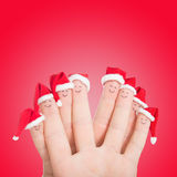 Fingers faces in Santa hats. Happy family celebrating concept Royalty Free Stock Image