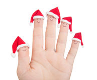 Fingers faces in Santa hats. Happy family celebrating Royalty Free Stock Photo