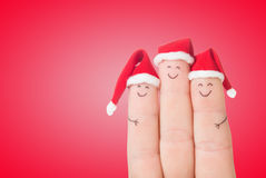 Fingers faces in Santa hats. Happy family celebrating Royalty Free Stock Photography