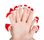 Fingers faces in Santa hats isolated on white background. Concep Royalty Free Stock Image