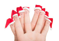 Fingers faces in Santa hats. Stock Photography