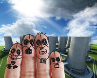 Fingers family. With nuclear power plant Royalty Free Stock Photography
