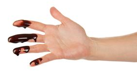 Fingers of female hand depicture chocolate Stock Photos