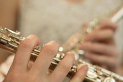 Fingers on flute Stock Photo