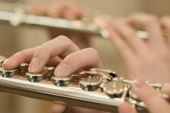 Fingers on flute Royalty Free Stock Photo