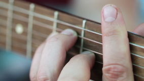 Fingers on frets stock video