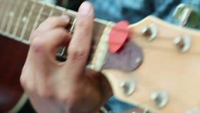 Fingers on frets stock video