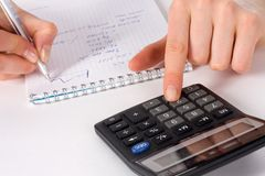 Fingers of girl press on calculator button Royalty Free Stock Photo