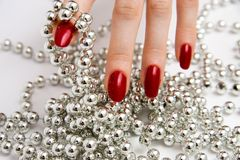 Fingers with glass beads stock image