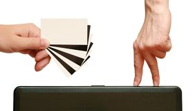 Fingers are going to contrast business card in han Stock Image