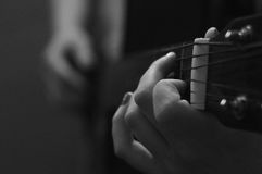 Fingers on guitar. Girl play song on guitar Royalty Free Stock Photos