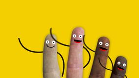 Fingers of a hand of various ethnic groups with smiley faces and arms greet us, ideal footage to represent integration. And racial problems, concept royalty free stock images