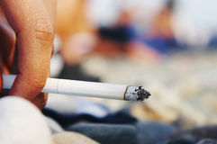 Fingers holding a cigarette Royalty Free Stock Photo
