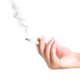 Fingers holding a cigarette with smoke Royalty Free Stock Photos