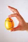 Fingers holding Easter egg Royalty Free Stock Image