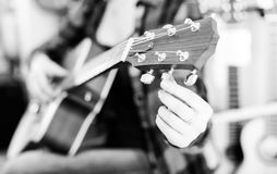 Fingers holding guitar pegs Royalty Free Stock Photography