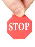 Fingers holding stop sign Royalty Free Stock Photos