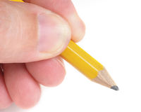 Fingers Holding Wooden Pencil stock image
