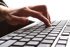 Fingers on keyboard. Fingers on the keyboard, pressing a key Stock Photography