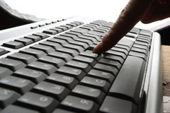 Fingers on keyboard. Fingers on the keyboard, pressing a key Royalty Free Stock Photos