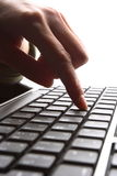 Fingers on keyboard. Fingers on the keyboard, pressing a key Royalty Free Stock Photography